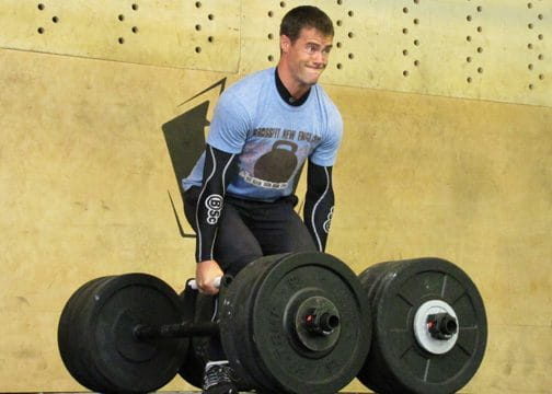 WOD from Ben Bergeron – 100 Rounds of HSPU, Cleans & Burpees