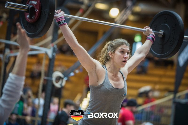 girls who lift female crossfit athlete with barbell