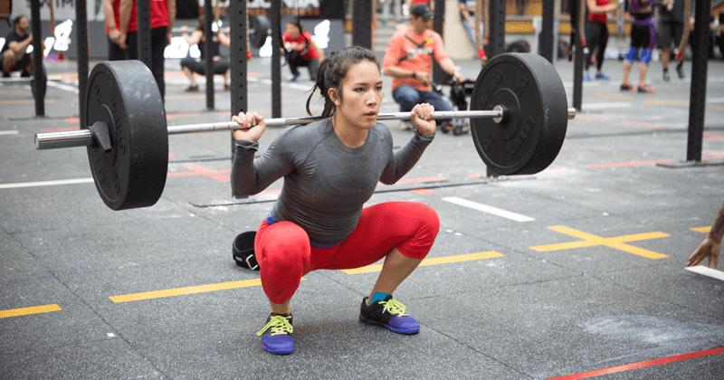 female crossfit athlete back squat with barbell girls who lift Gluteal Amnesia