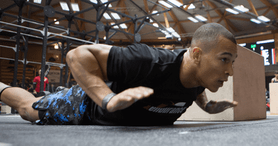 Crossfit athlete perfoms burpees