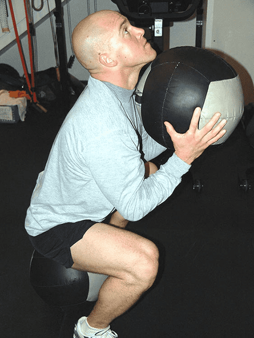Training with a Wall Ball on the floor can improve your movement