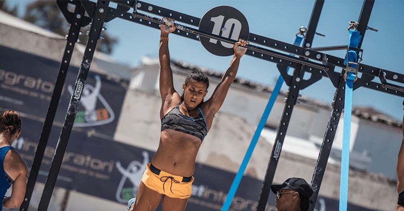 crossfit girl strict pull ups during amrap wod