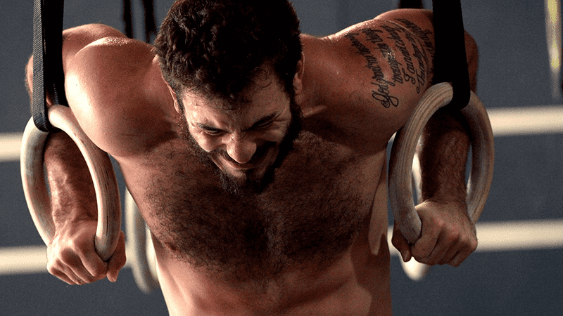 Mat Fraser pushing through a Muscle Up