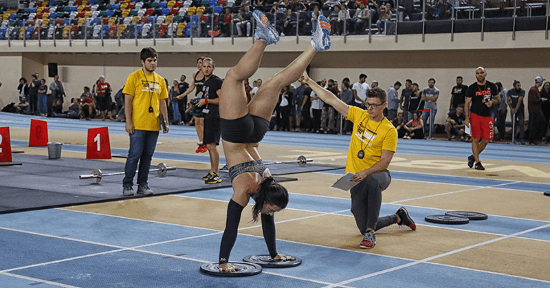 Female Crossfitter handstand-walks