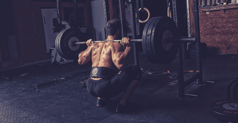 rich Froning back squat in crossfit box