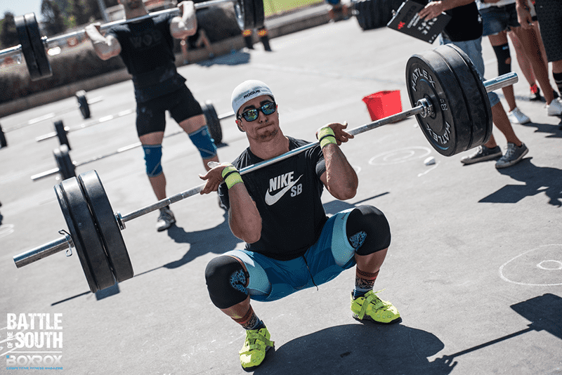 crossfit guy barbell clean lift in oly lifting shoes