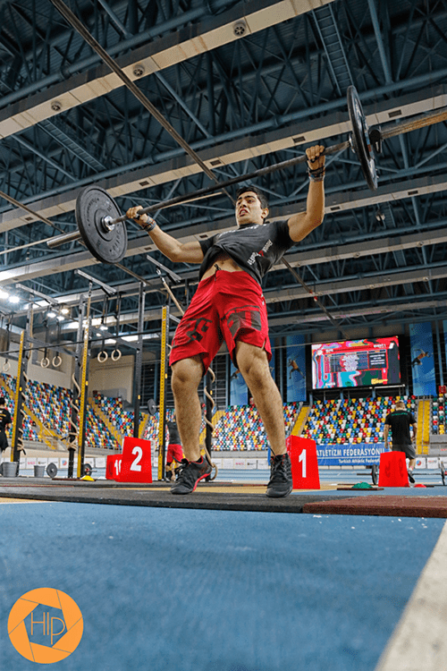 male crossfiter snatch barbell lift in competition