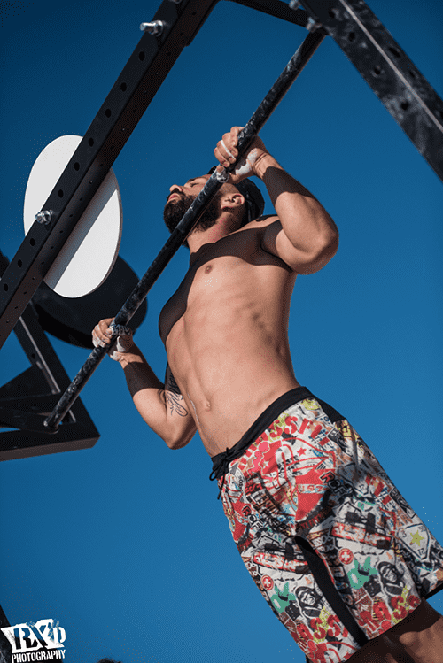 Male crossfit athlete pull up bodyweight wods