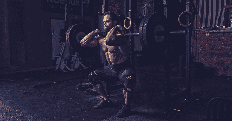 rich froning does a front squat in crossfit box