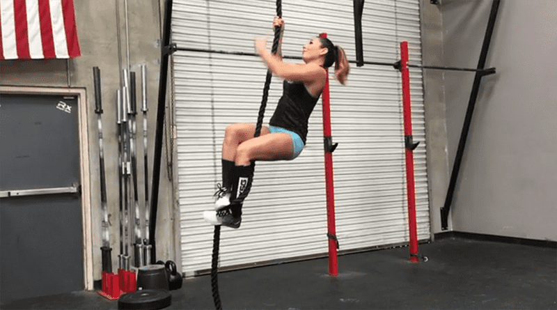 female crossfit athlete uses S wrap drip to rope climb