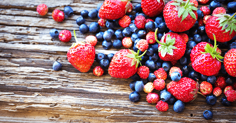 superfoods berries on wooden surface