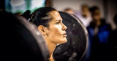 female crossfit athlete face determined in zone