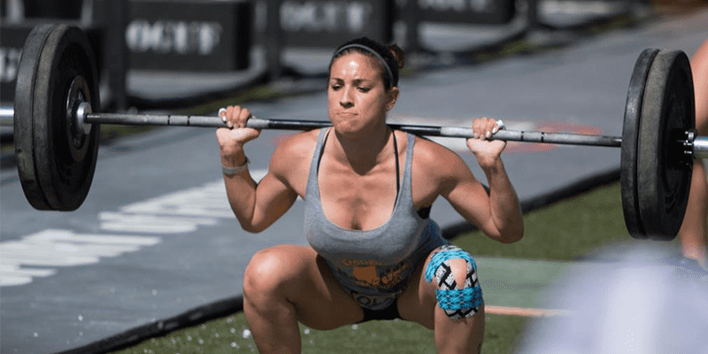 female crossfitter squatting