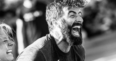 hammer crossfit athlete shouting during cable exercises