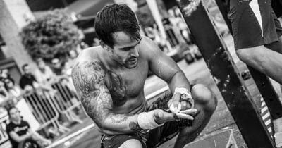 male crossfitter chalks hands nutritional foundation