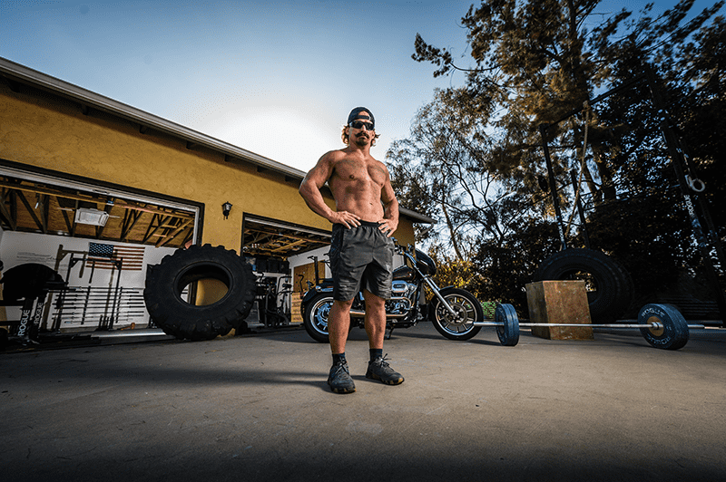 josh Bridges crossfit athlete wearing gatorz sunglasses in his backyard gym