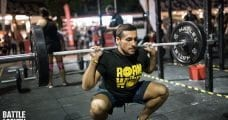 ectomorph male athlete squatting