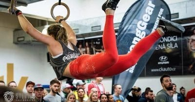 gymnastic wods female crossfitter ring muscle up eating right importance of recovery kipping