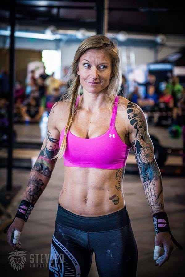 Crossfit woman tattoos pink top before wod
