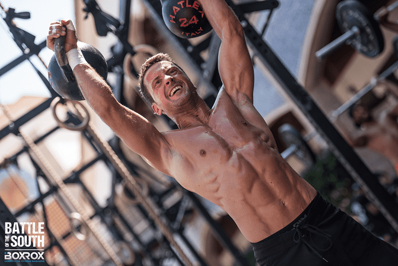 paleo diet male crossfit athlete kettlebell press