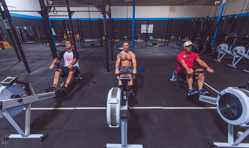 Chris Hinshaw training mat fraser and jason khalipa on the rowing machine