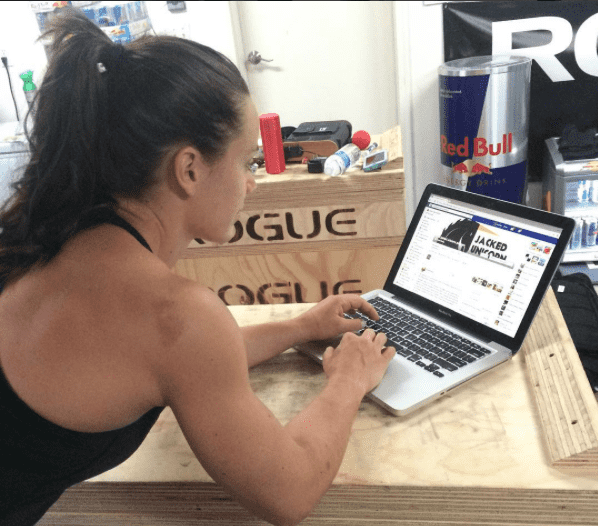 camille leblanc bazinet female crossfit athlete works on laptop