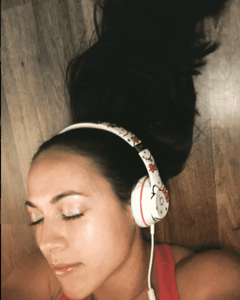 crossfit games athlete Alessandra Pichelli listening to music for motivation