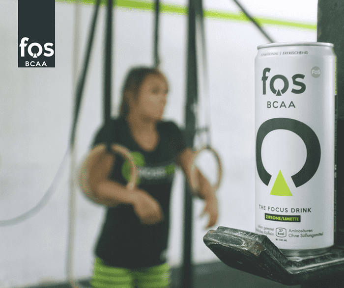 fos focus drink female crossfit athlete on rings
