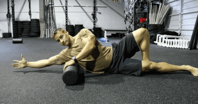 male crossfit athlete foam rolling
