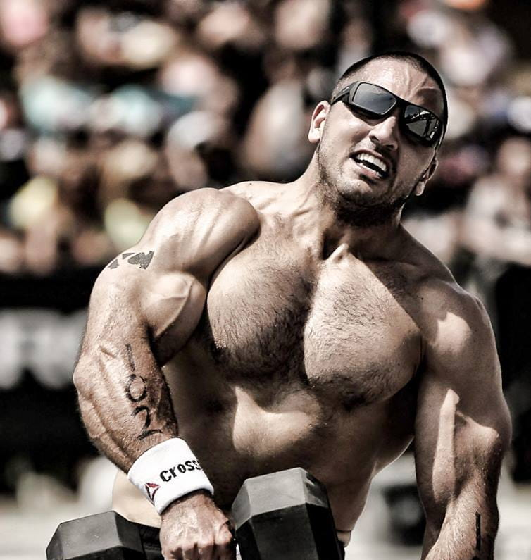 Crossfit athlete Jason Khalipa performs dumbbell snatches in competition