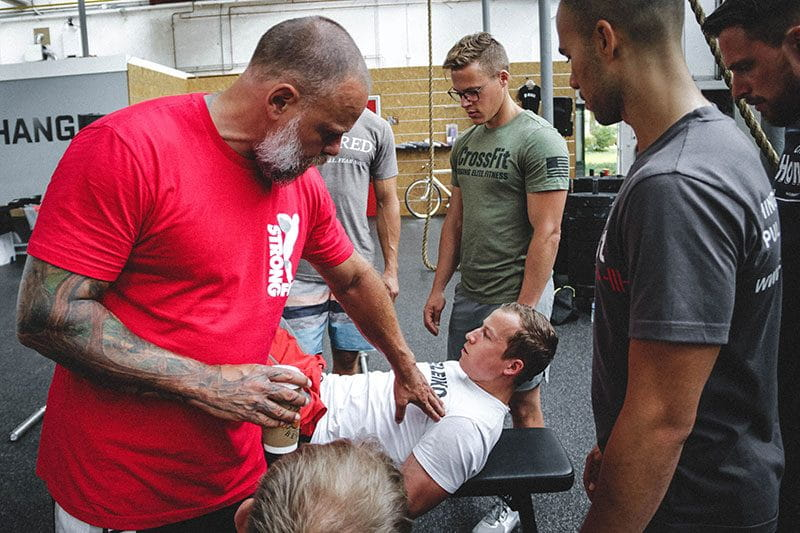 Julien Pineau crossfit coach works with athletes