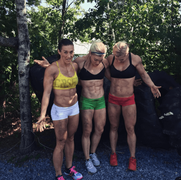 crossfit girls perform crossfit exercises