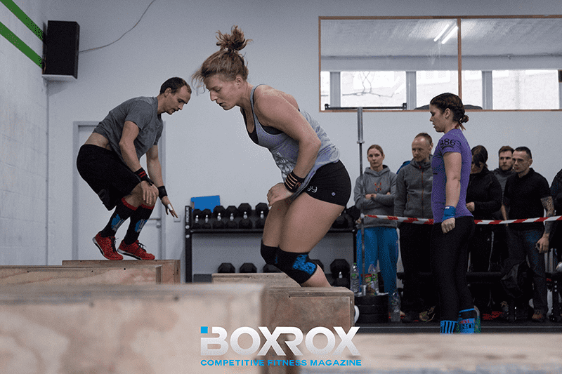 crossfit athletes performing box jumps during competition
