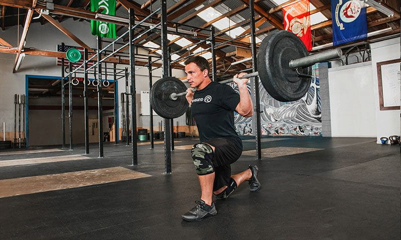 Crossfit games athlete Josh Bridges trains core strength with lunges