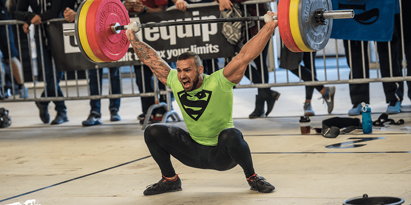 Snatch olympic lifting technique crossfit male athlete