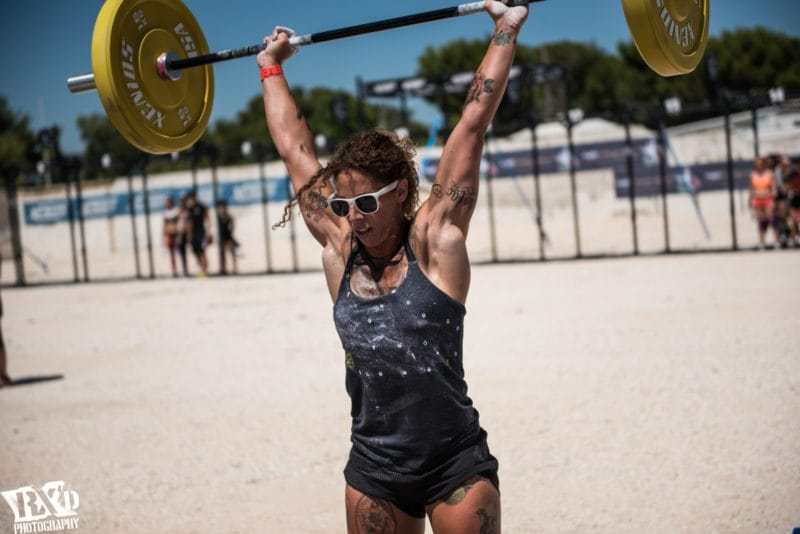 crossfit female athlete performs push press