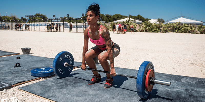 crossfit girl emom workouts outside beach