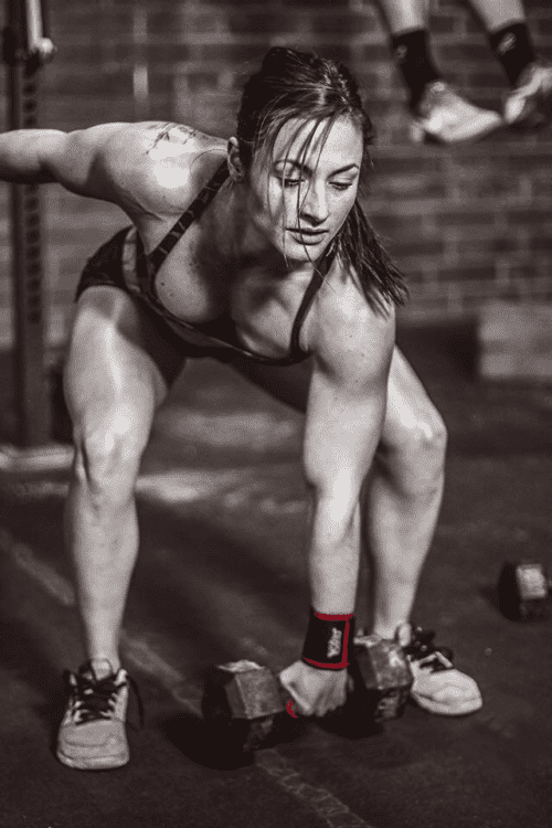 hand rips dumbell snatches female crossfitter