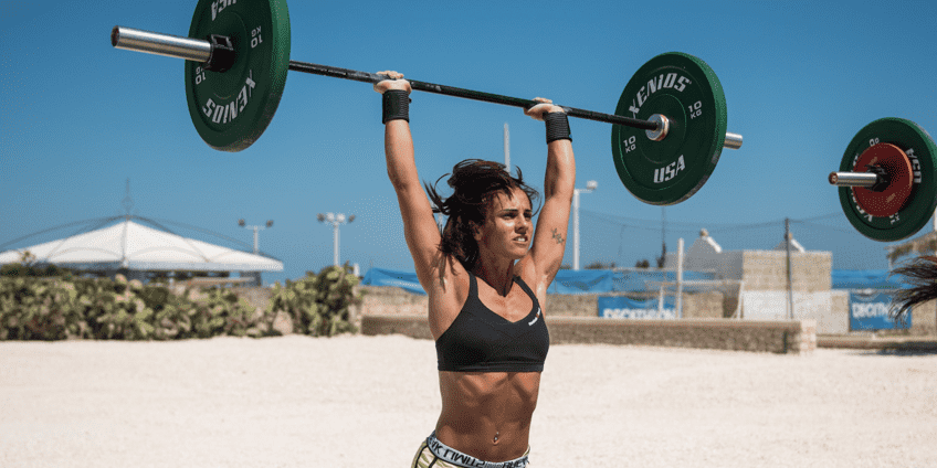 female crossfit athlete overhead press