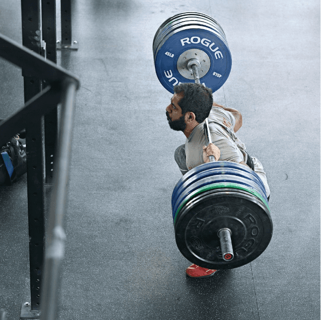 male crossfit athlete performs back squat