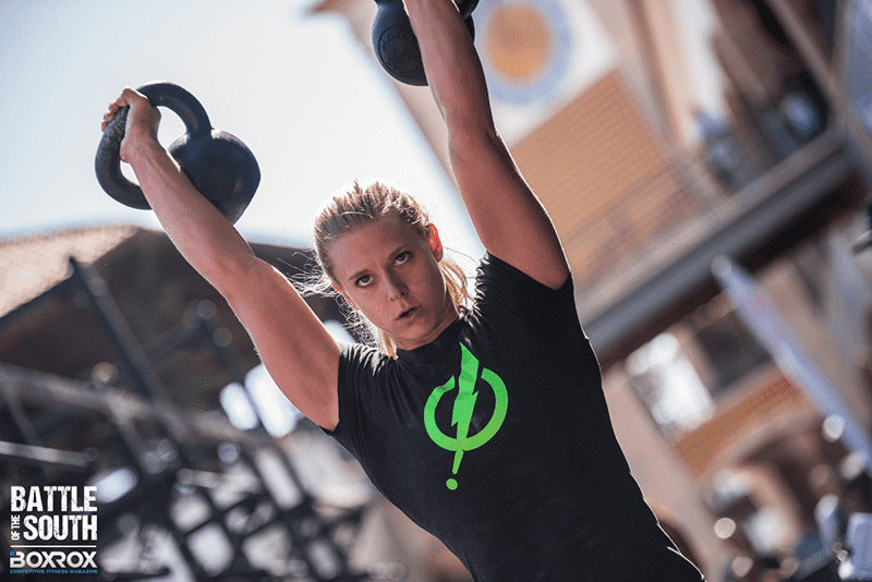 female athlete kettlebells