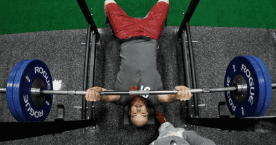 male athlete bench press