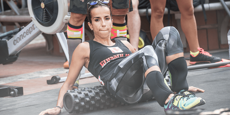 Foam-Rolling Female Crossfit Athlete
