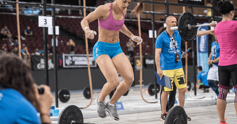crossfit athlete bar facing burpees
