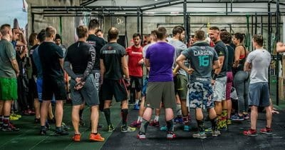 crossfitters crowd before workout