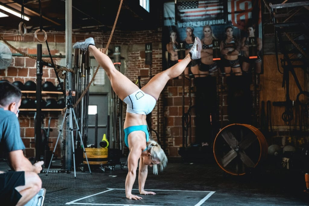 athlete dani speegle holds handstand during crossfit games workout