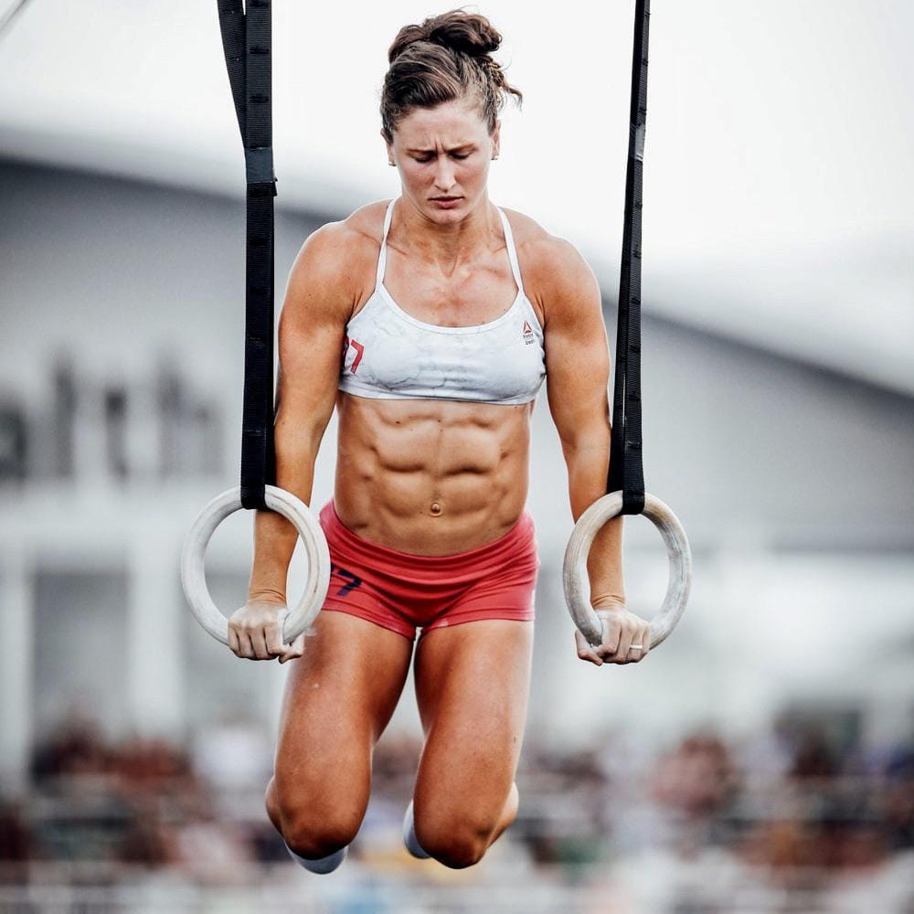 tia clair toomey performs ring muscle up workout