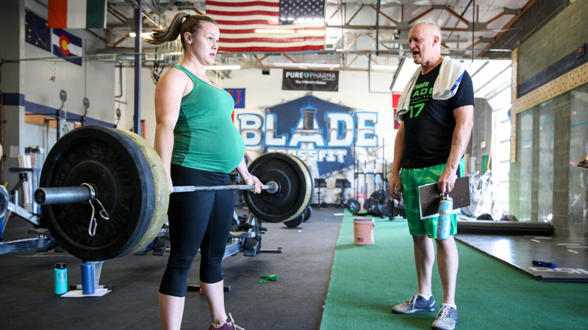 pregnant athlete performs deadlift back workouts