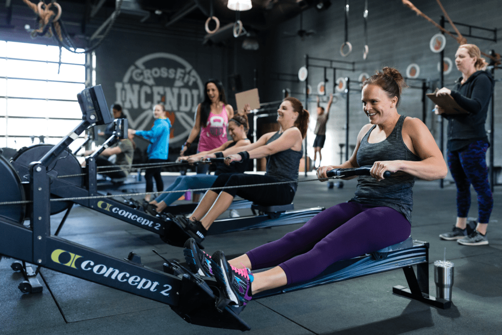 crossfit class doing rowing workouts