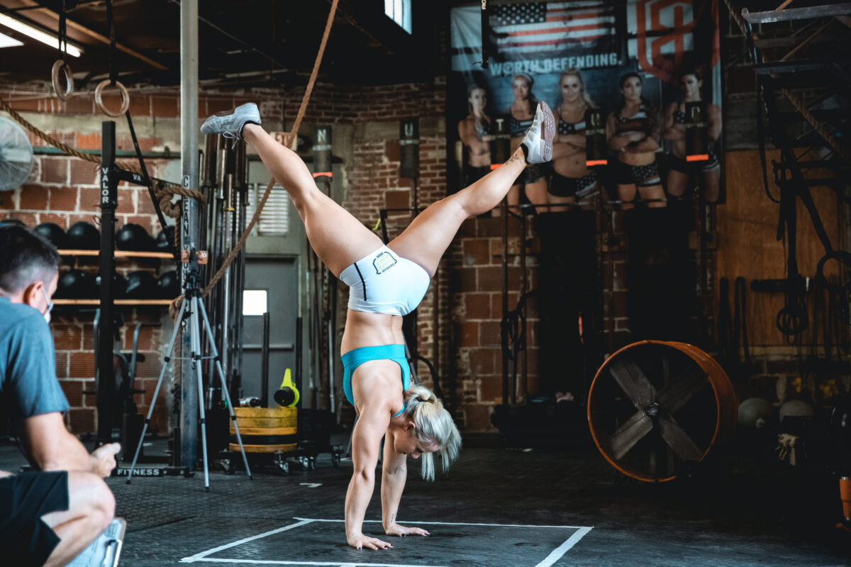 dani speegle performs gymnastics abs workouts with handstand hold